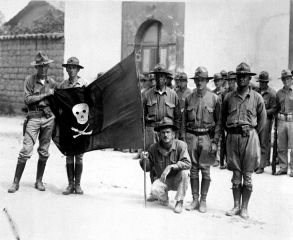 U.S._Marines_holding_Sandino's_Flag_-_Nicaragua_1932.jpg